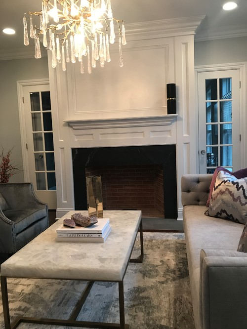 A designer I used to work with said my fireplace was an eye sore and suggested I paint it black or white. Is this something that you would do? And is it safe to just paint it given flammability of paint?