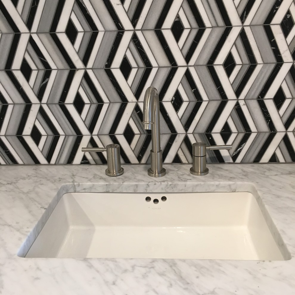 Mid-sized minimalist master black and white tile and marble tile marble floor and gray floor bathroom photo in Atlanta with flat-panel cabinets, gray cabinets, gray walls, a drop-in sink, marble countertops, a hinged shower door and white countertops