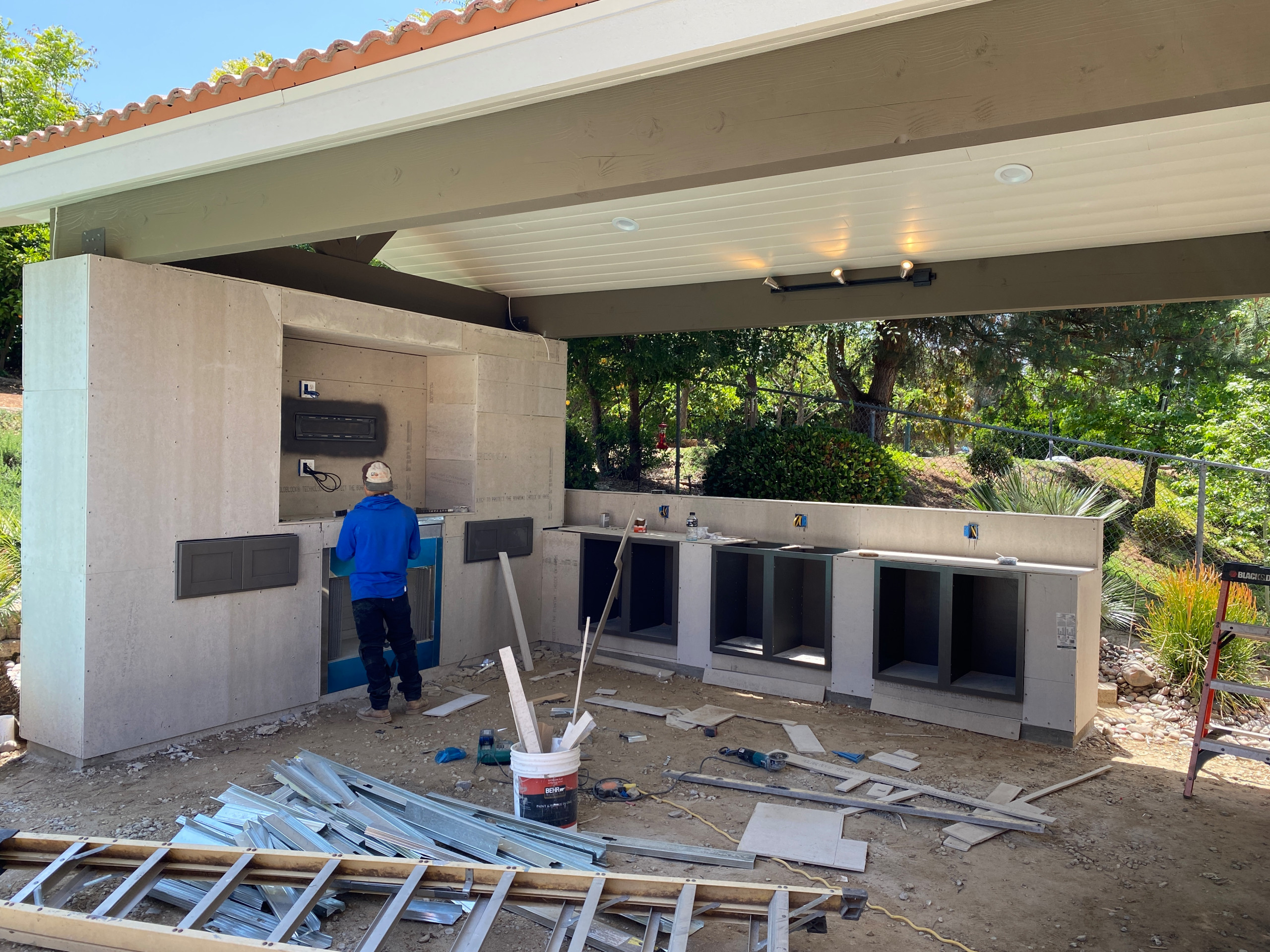 Building a TV wall with a Fireplace and Cabinet Storage in El Cajon