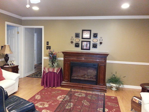 I have a Fireplace/Lift TV cabinet that stands out 26 inches from the wall.  There are two entry exit doors to the left of the cabinet if you are standing in front looking at it