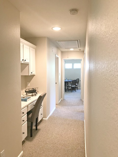 Mid-sized elegant carpeted and beige floor hallway photo in Houston with beige walls