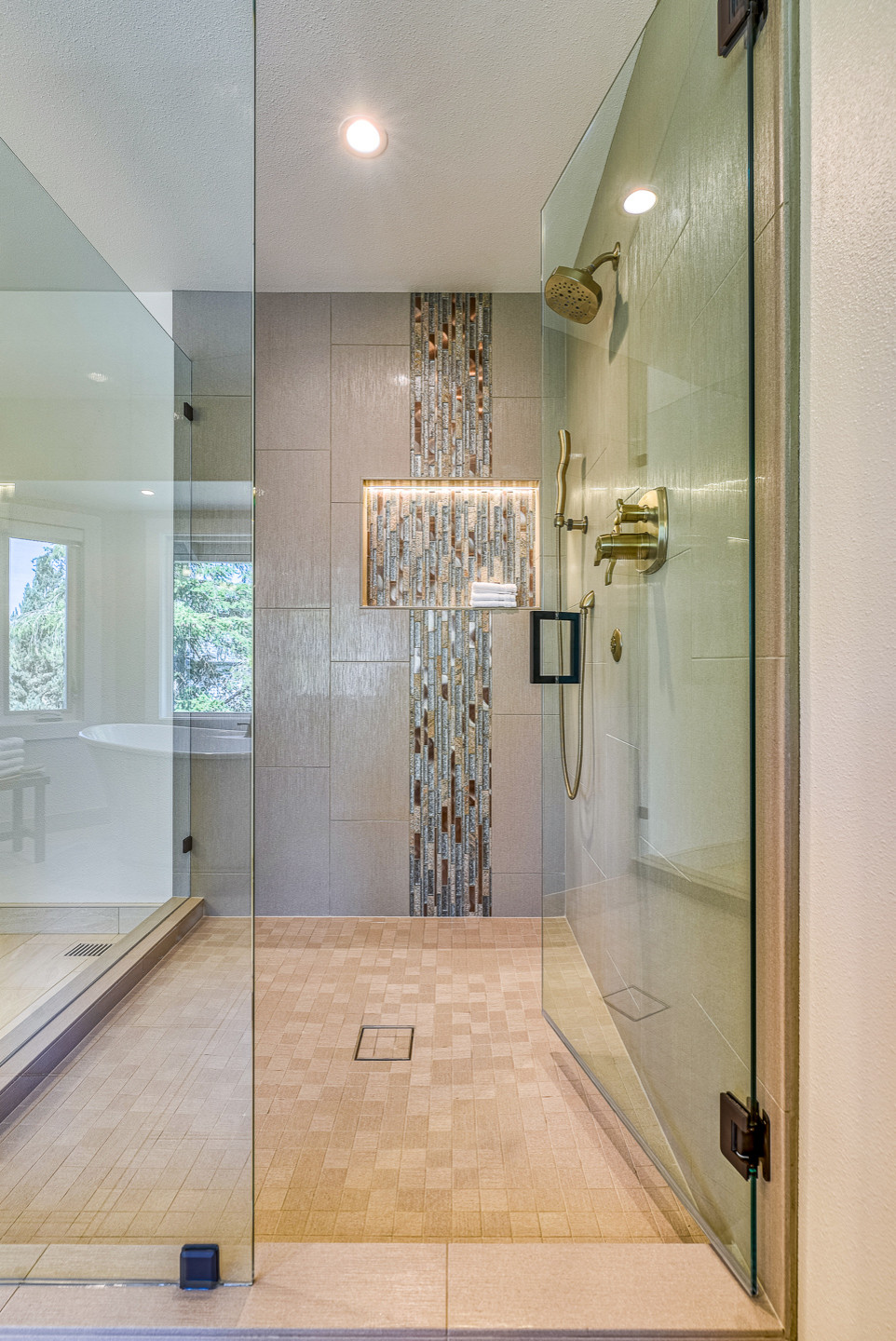 This 90's beauty had an odd layout with a built-in tub deck.  It had a closed off layout and was dated with striped wallpaper, tiled countertops and gold fixtures. We removed the tub deck and installe
