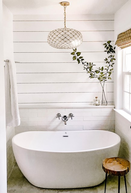 Mid-sized trendy master white tile and ceramic tile ceramic floor and beige floor freestanding bathtub photo in Charlotte with a two-piece toilet, white walls, an undermount sink, engineered quartz countertops, a hinged shower door and white countertops