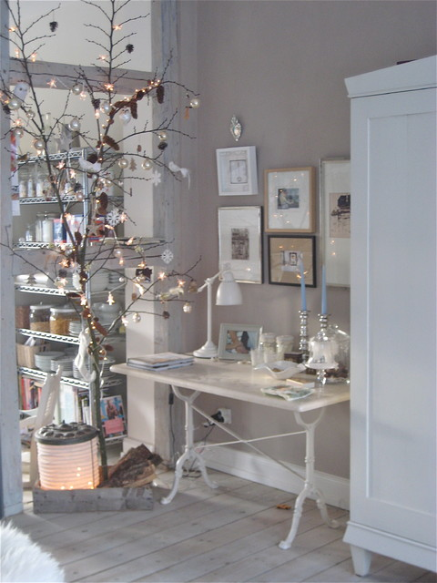 Twinkling branch for the Holiday season eclectic-dining-room