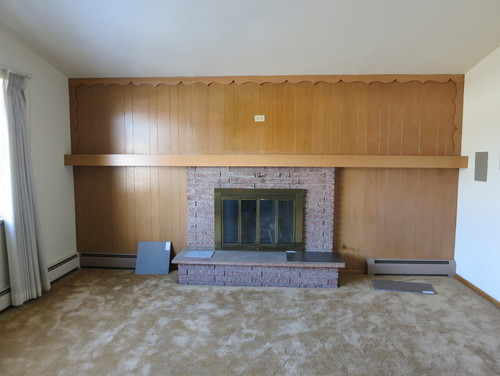 Natural wood wainscoting in mid century modern home for Mid century modern baseboard
