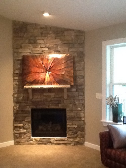 What height should I hang artwork over fireplace ?    My husband protested not putting a TV over the fireplace