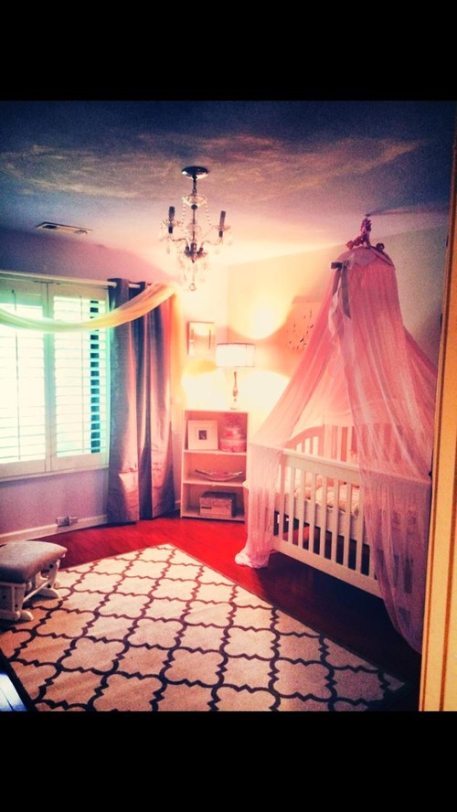 our baby's bedroom.. chandelier, painted clouds ceiling, drapes