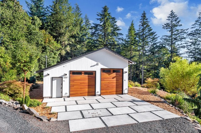 Garage - large modern detached four-car garage idea in Portland