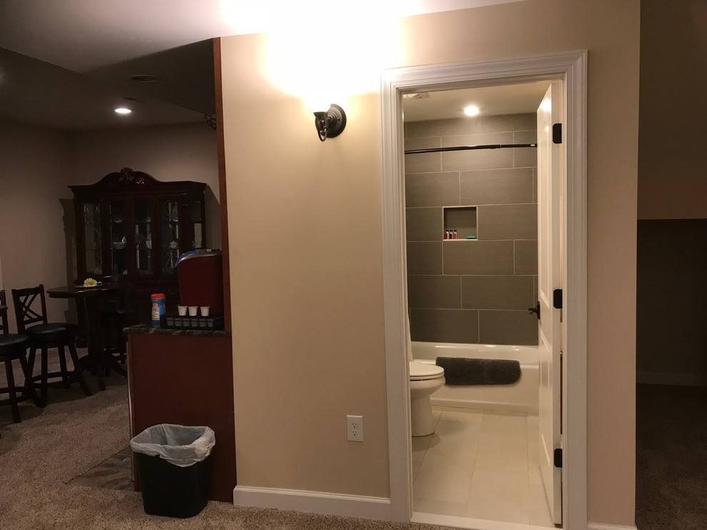 Finished Basement Bathroom with ceramic tile floor and tub