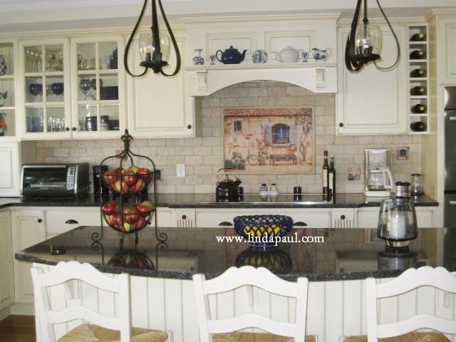 French country kitchen with white cabinets and black for Kitchen remodel ideas black granite