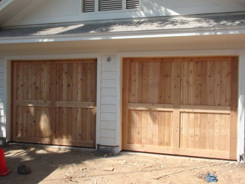 Build our own wood garage door for Garage door opens on its own