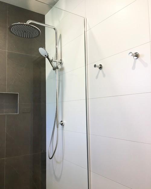 Chrome robe hooks in bathroom renovation