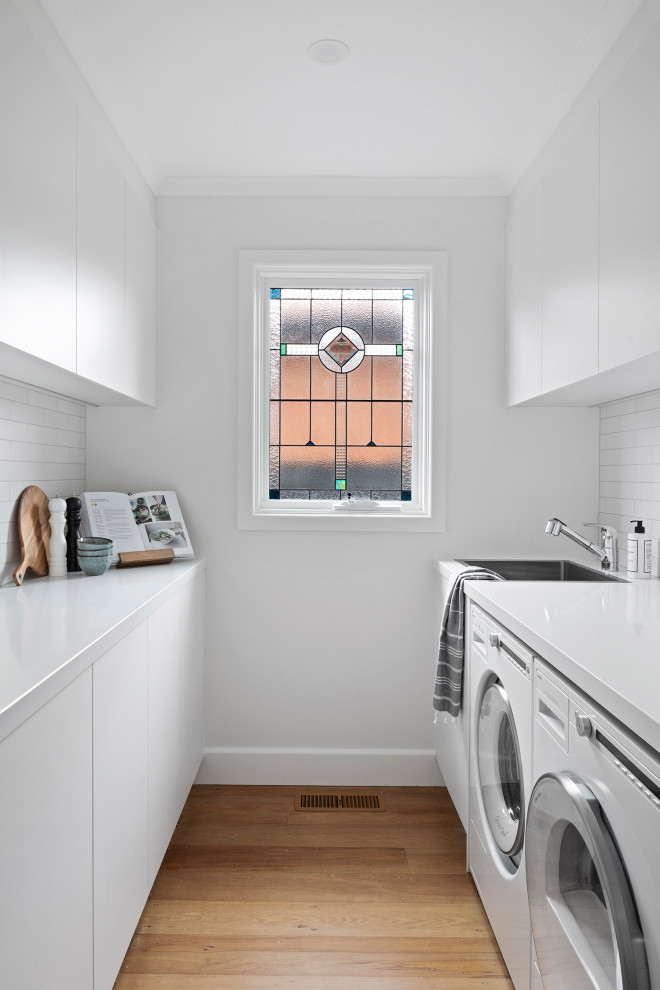 Design ideas for a contemporary laundry room in Melbourne.