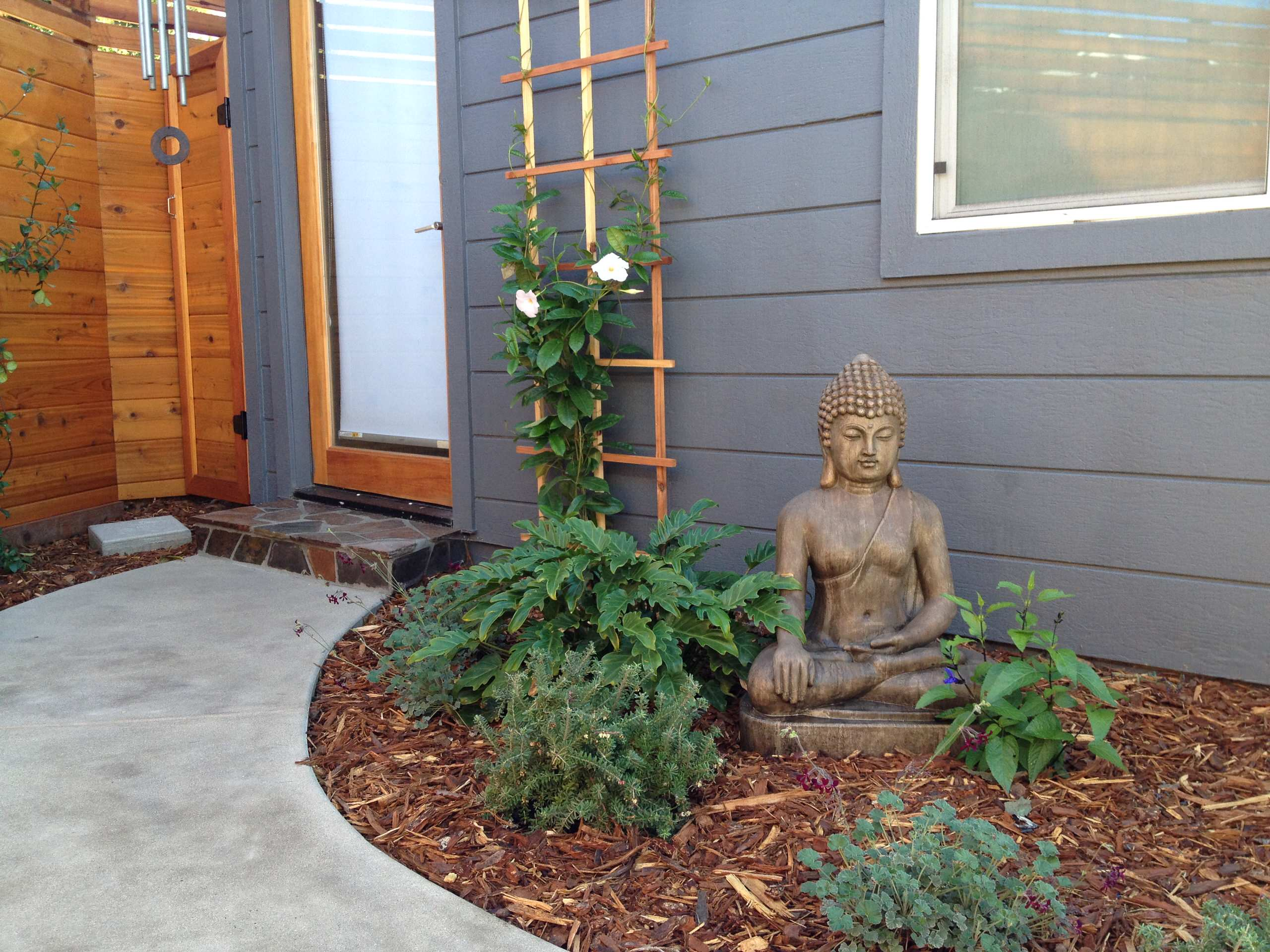 Garden Art Tucked Into the Plantings