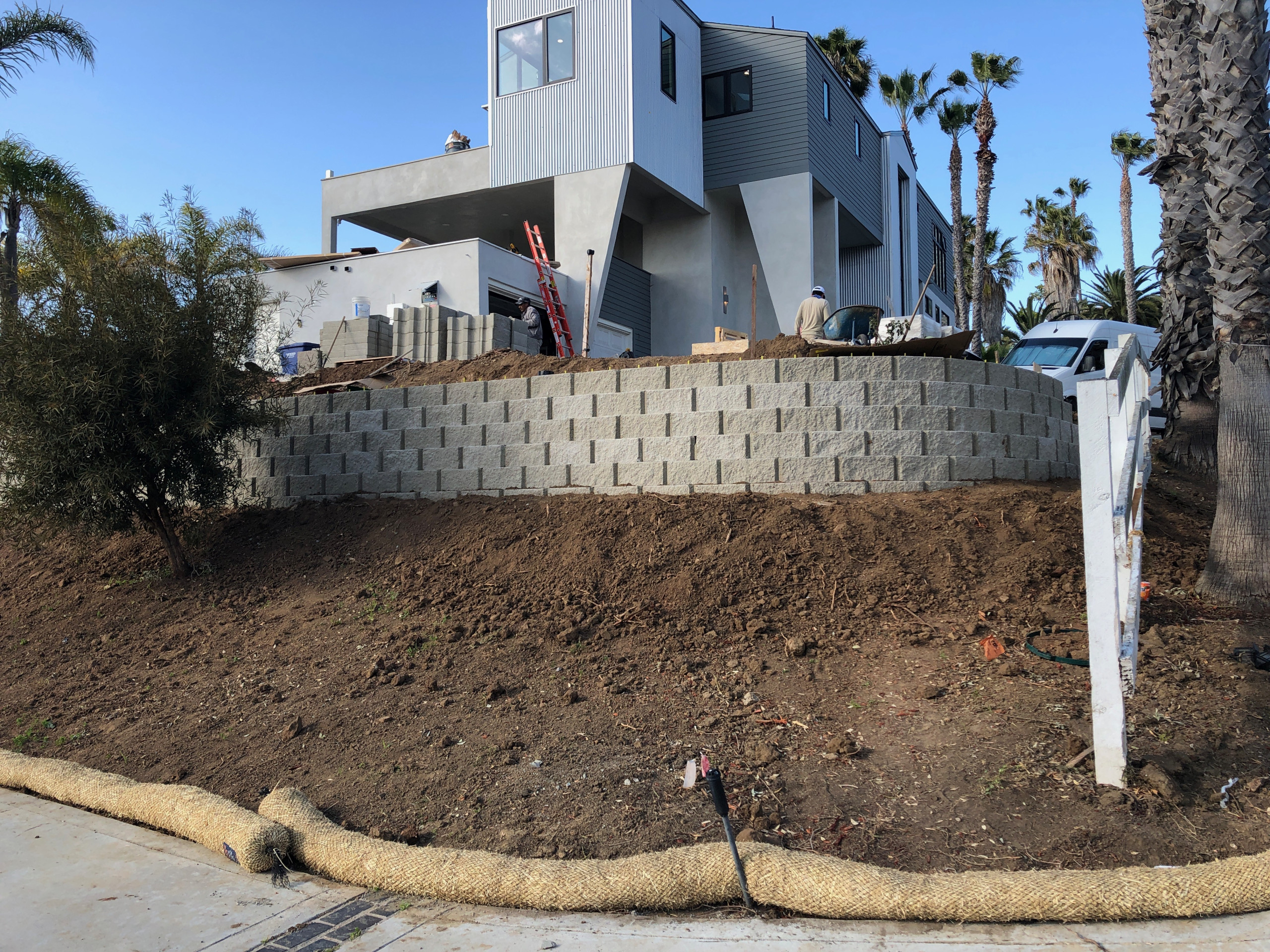 Installing Two Large Retaining Walls on a Slope