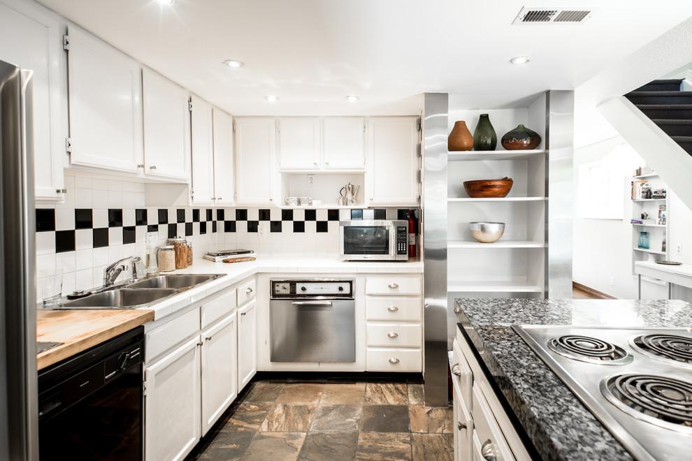 Transitional home design photo in Denver