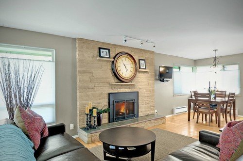 Originally a wood burning fire place that was converted to gas. The entire front side of my house is the same brick running up to the chimney. It is extremely large and would like some ideas on how to update it. My  home is mid century modern.  I have enclosed the real estate photos when I bought th...