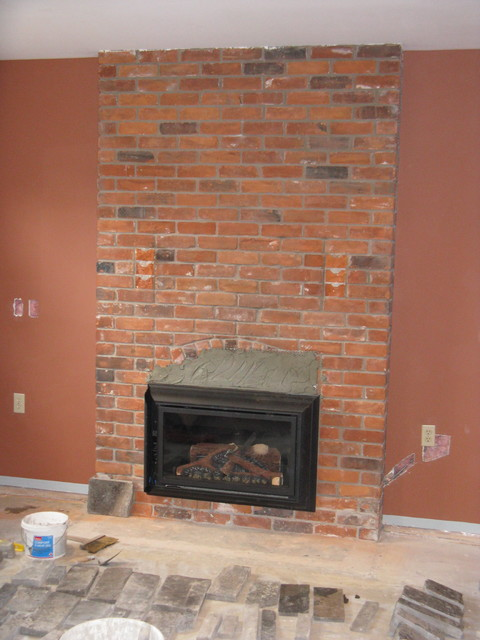 Natural Stone Veneer Directly Over Existing Brick Fireplace  Traditional Basement