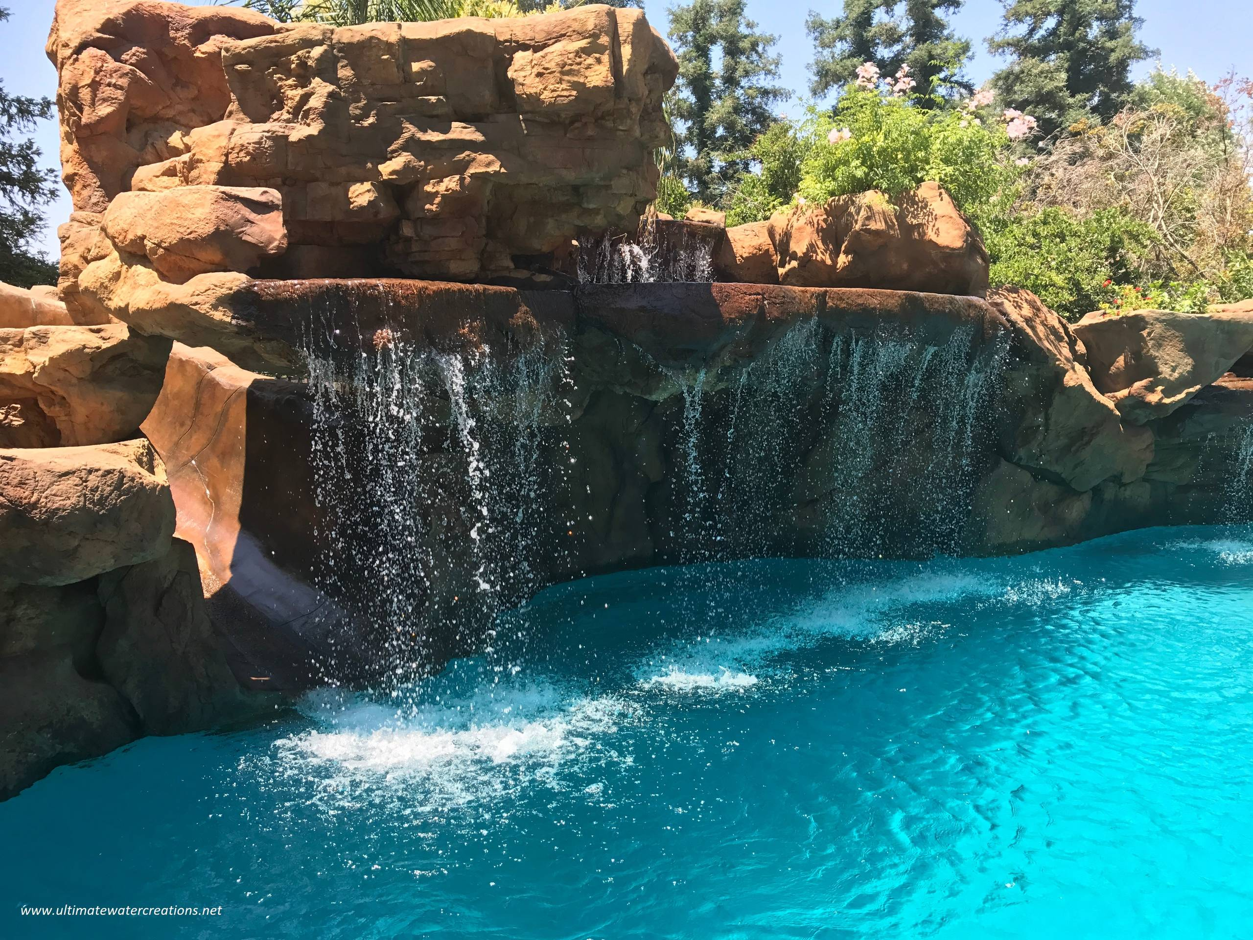 Naturalistic Pool and Spa with Waterfalls, a Slide and Koi Pond