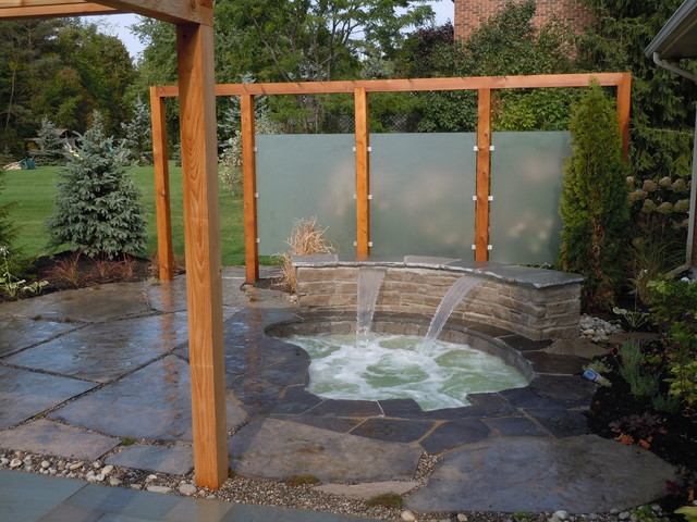 Inground spa with waterfall patio and privacy screens for Garden feature screens
