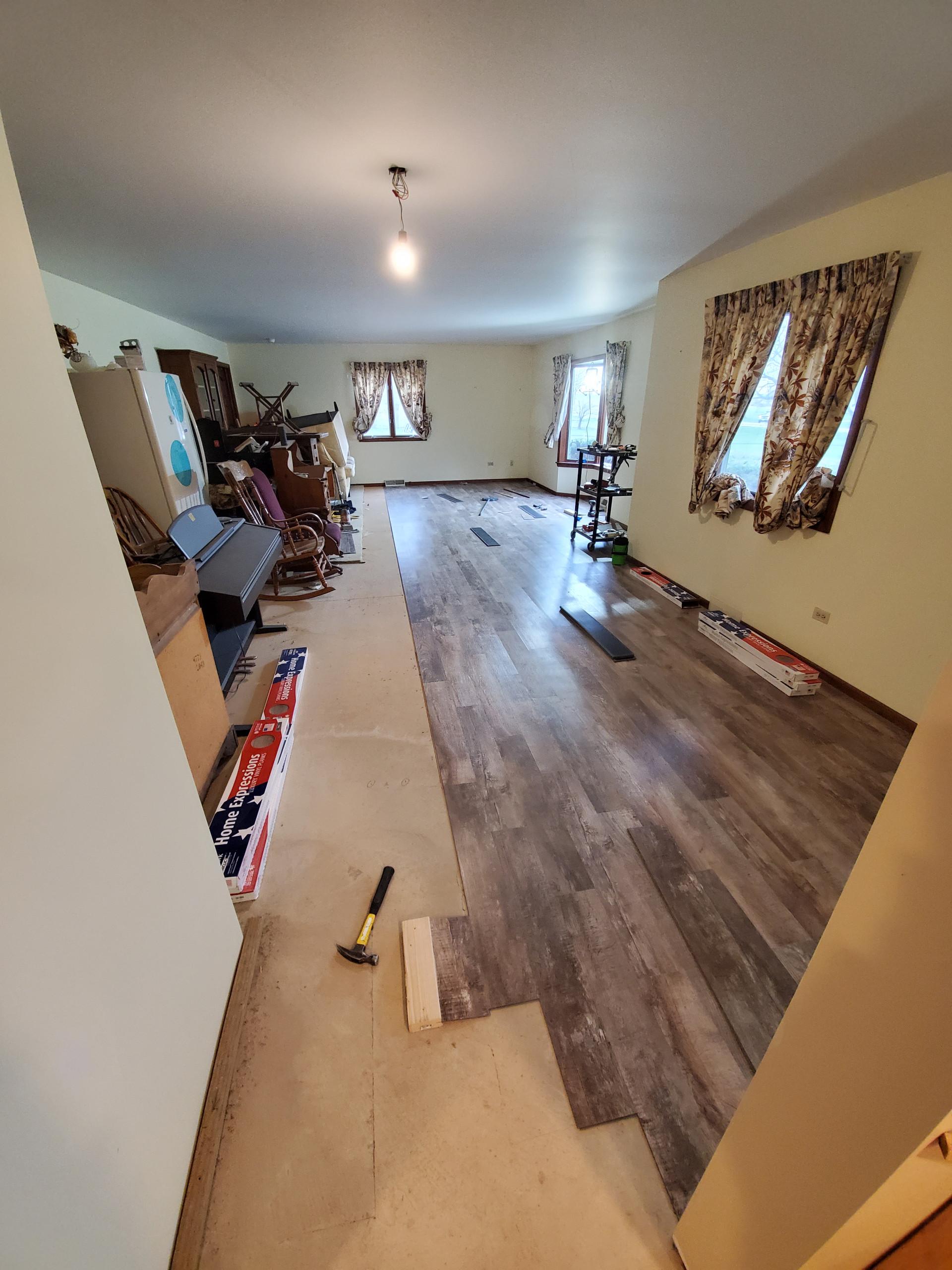 Vinyl plank flooring in progress