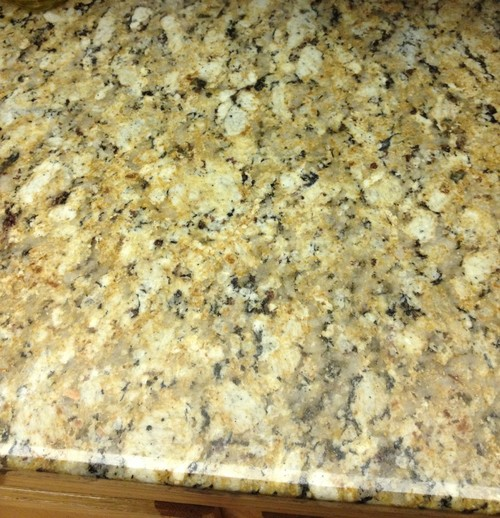 painting countertops to look like granite staining or painting kitchen cabinets