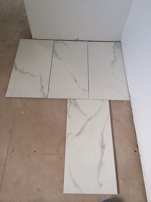 I Cannot Choose Which Tile To Use For Master Ensuite Carrara Marble Or Calcutta Porcelain Will Be Using A Dark Vanity With White Top So Either