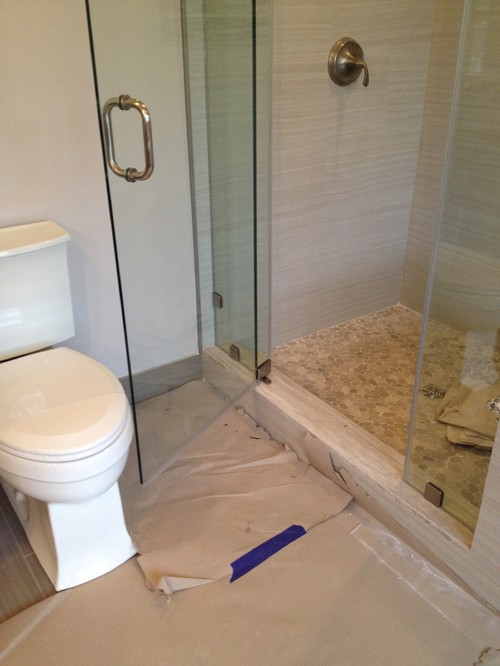 New shower glass door hits the toilet