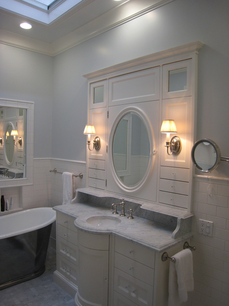 White built in vanity and marble sink