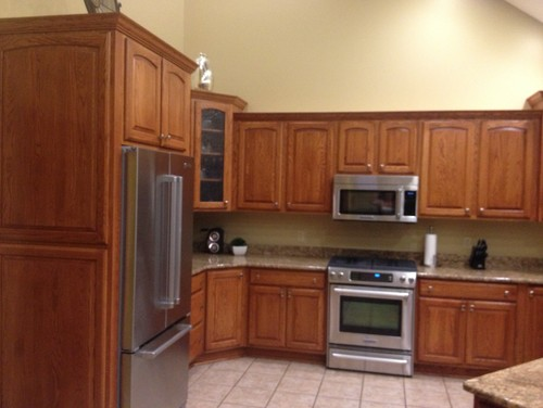 Oak kitchen cabinets help what to do stain or paint for Kitchen cabinets 75 off