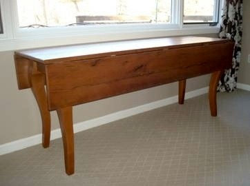 Drop Leaf Table In Brown Cherry Finish
