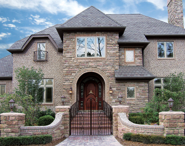 Majestic colonial house coronado manufactured stone veneer for Stone facade house