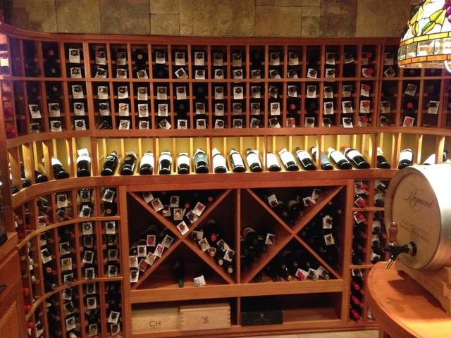 Led lighting over the display wine racks custom wine for Home wine room lighting effect