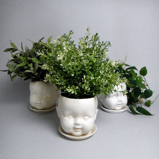 Porcelain baby doll head planter eclectic vases