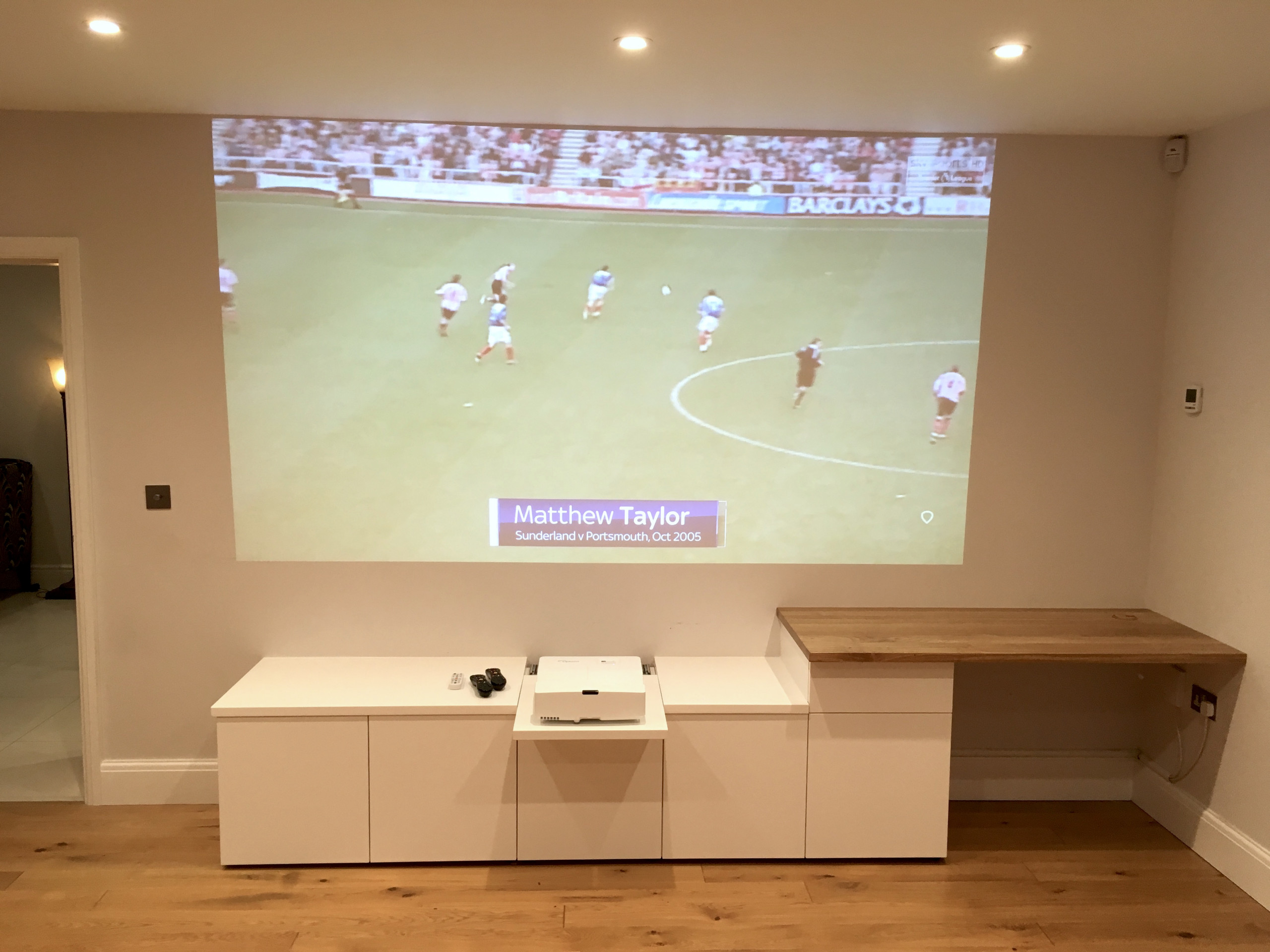 Minimalist Storage Unit with Projector and Desk