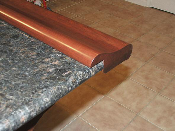 Chicago Bar Rail Fastened To Granite