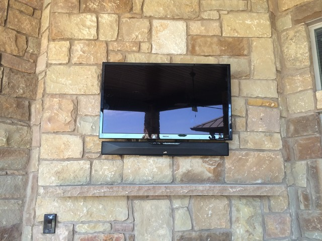 Outdoor Tv With Soundbar Above Fireplace On Porch