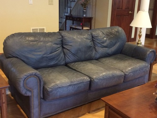 Does this leather sofa look tastefully aged or trashed?