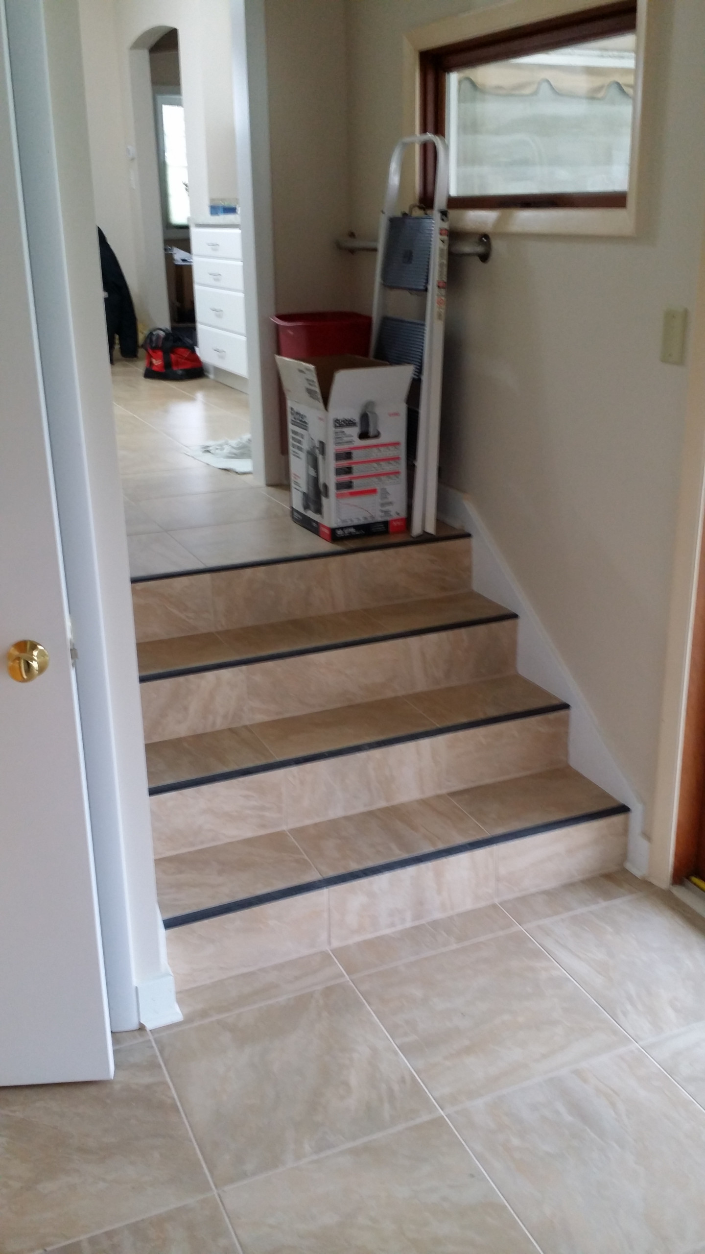 Tile stairs with rubber nosing