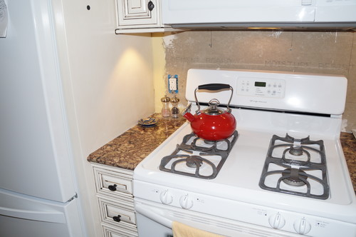 Dilemna: Stove too close to refrigerator cabinet... Protection ideas?
