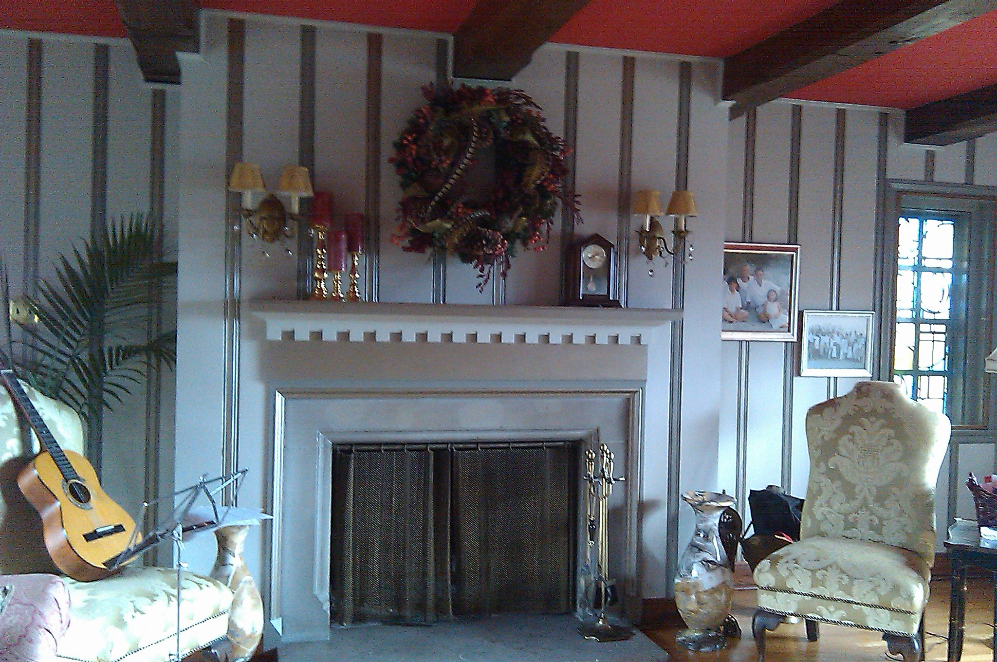 Specialty Painting Paneled Wall and Fireplace