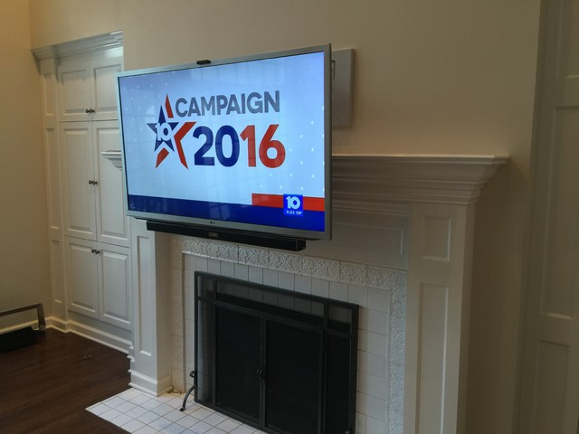 HDTV Mounted over Fireplace with Drop Down Mantel Mount and ... on