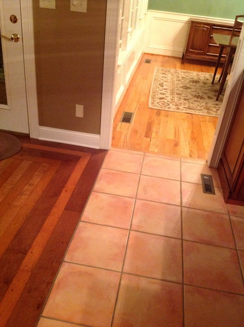 What to replace tile floor with in kitchen with 2 Different design and colors of tiles