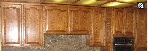 Can Oak cabinets be refinished to Cherry color cabinets?