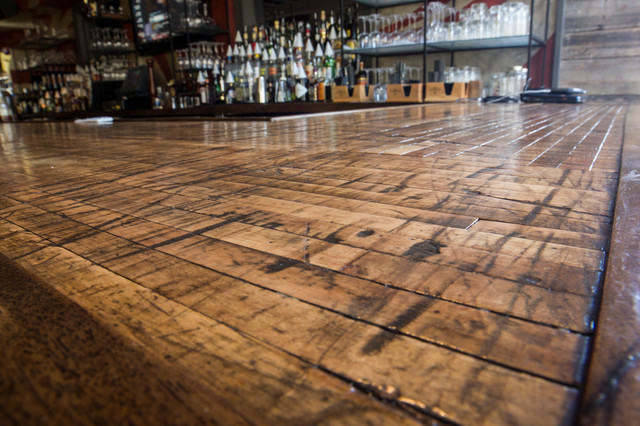 Close Up Of Reclaimed Boxcar Plank Bar Top Rustic Home