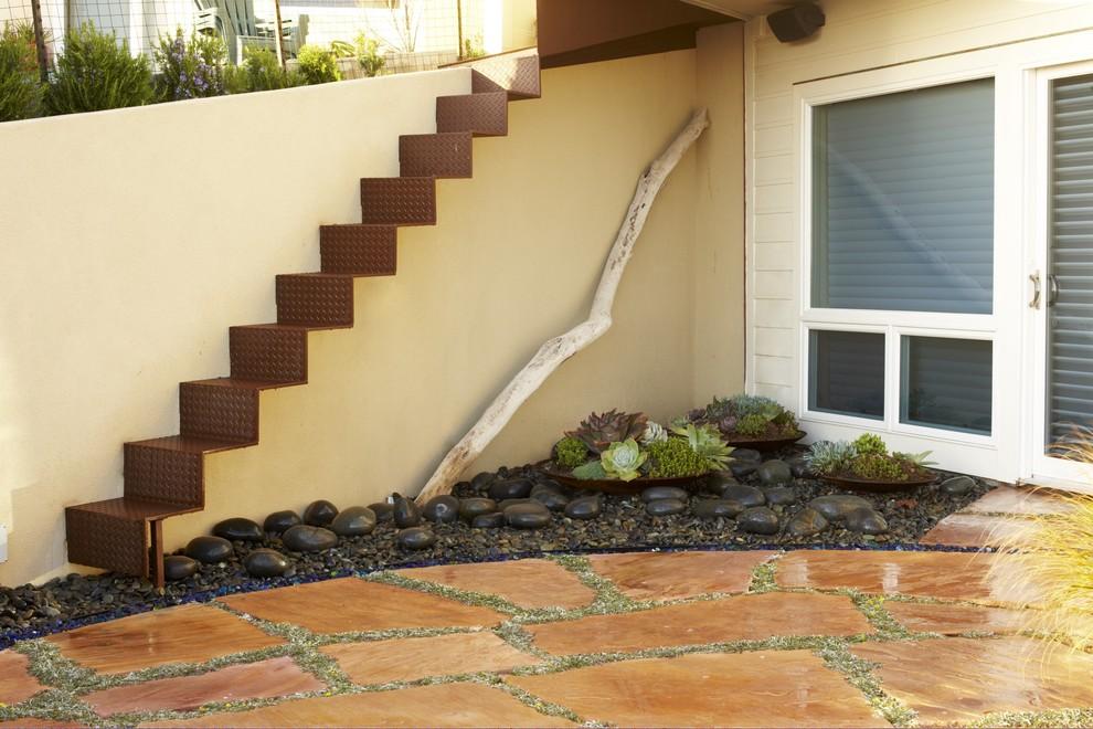 Design ideas for a coastal courtyard stone landscaping in San Luis Obispo.