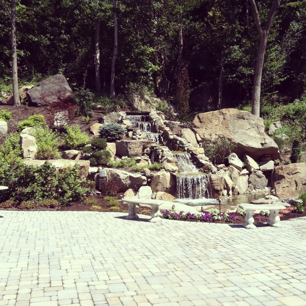 before and after landscape waterfall pond and paver patio