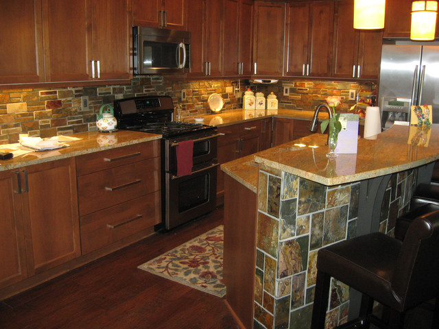 Kitchen Backsplash Dark Wood Cabinets dark wood cabinetry with stacked stone backsplash & island