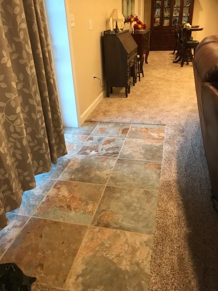 Finished Basement with Porcelain tile by sliding door