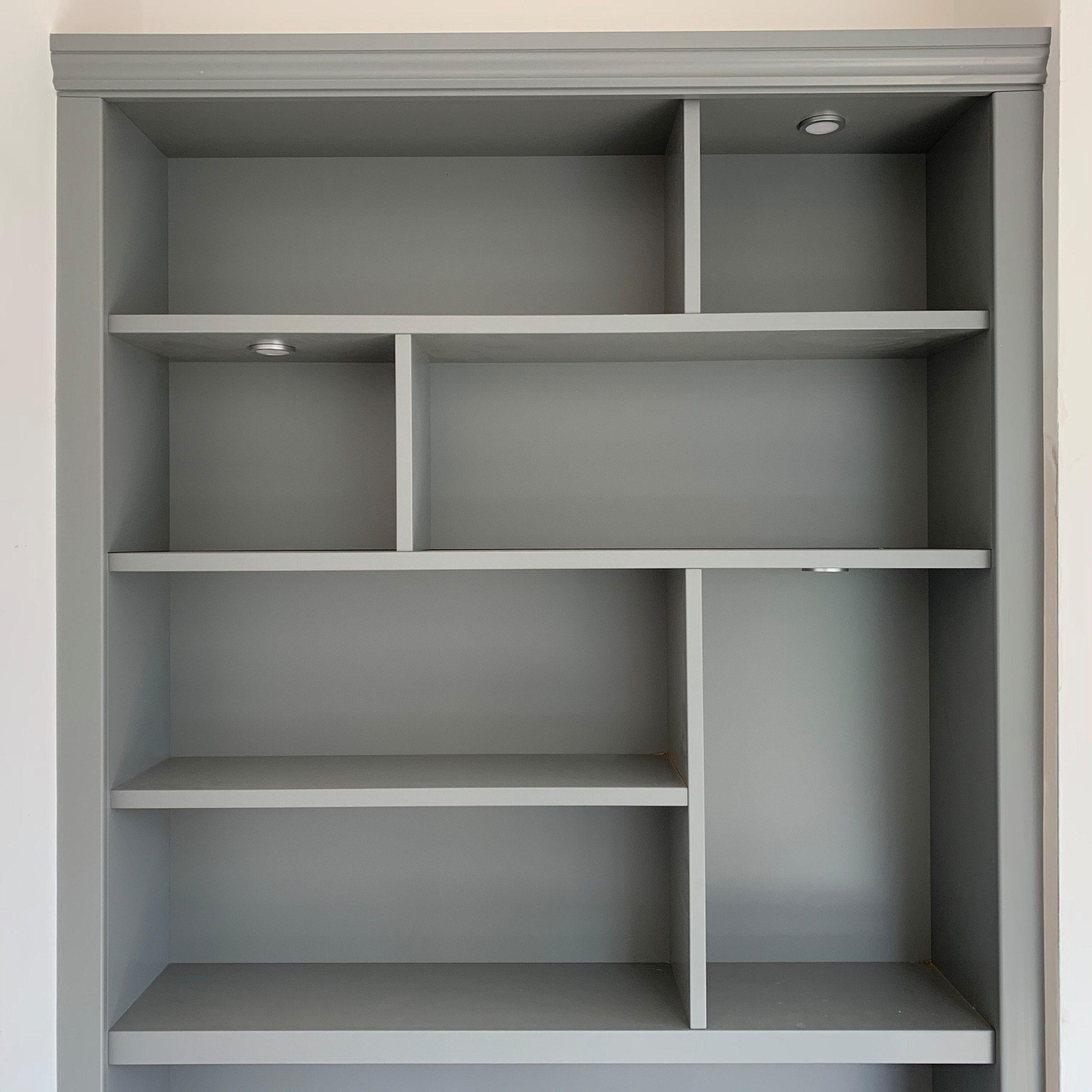 Classic grey bookcase shelving with lighting and dividers